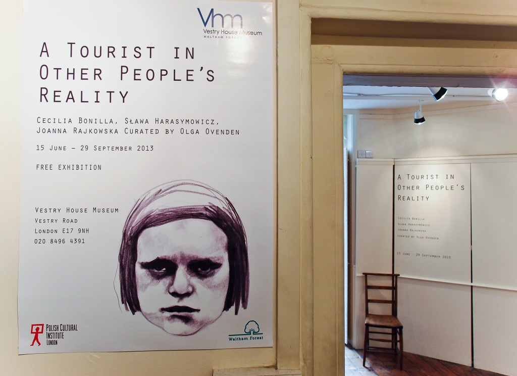"""A poster of the exhibition """"A tourist in other people's reality"""" exhibition by Cecilia Bonilla, Sława Harasymowicz and Joanna Rajkowska. Curated by Olga Ovenden,Vestry House Museum, August 2013, Photo Slawek Kozdras for Contemporary Lynx"""