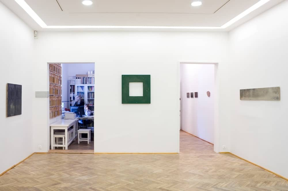 """Revitalizations, 2009, oil on canvas, 29"""" x 29"""", In the center of this photo a painting from the previous image installed in the white cube of the gallery."""