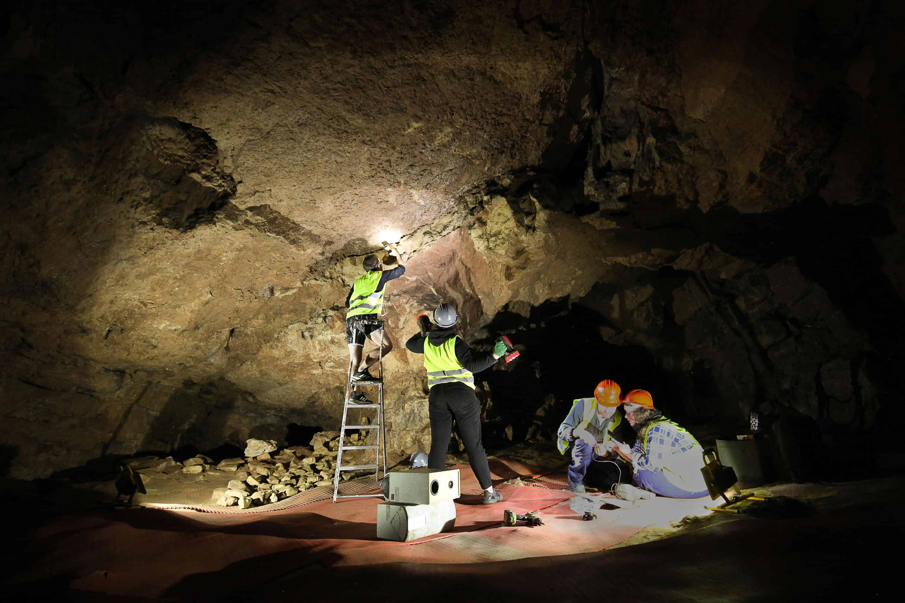 AlanJames Burns and his team installing Entirely hollow aside from the dark inside Creswell Crags Caves, September 2019, Photo Marek Wolynski
