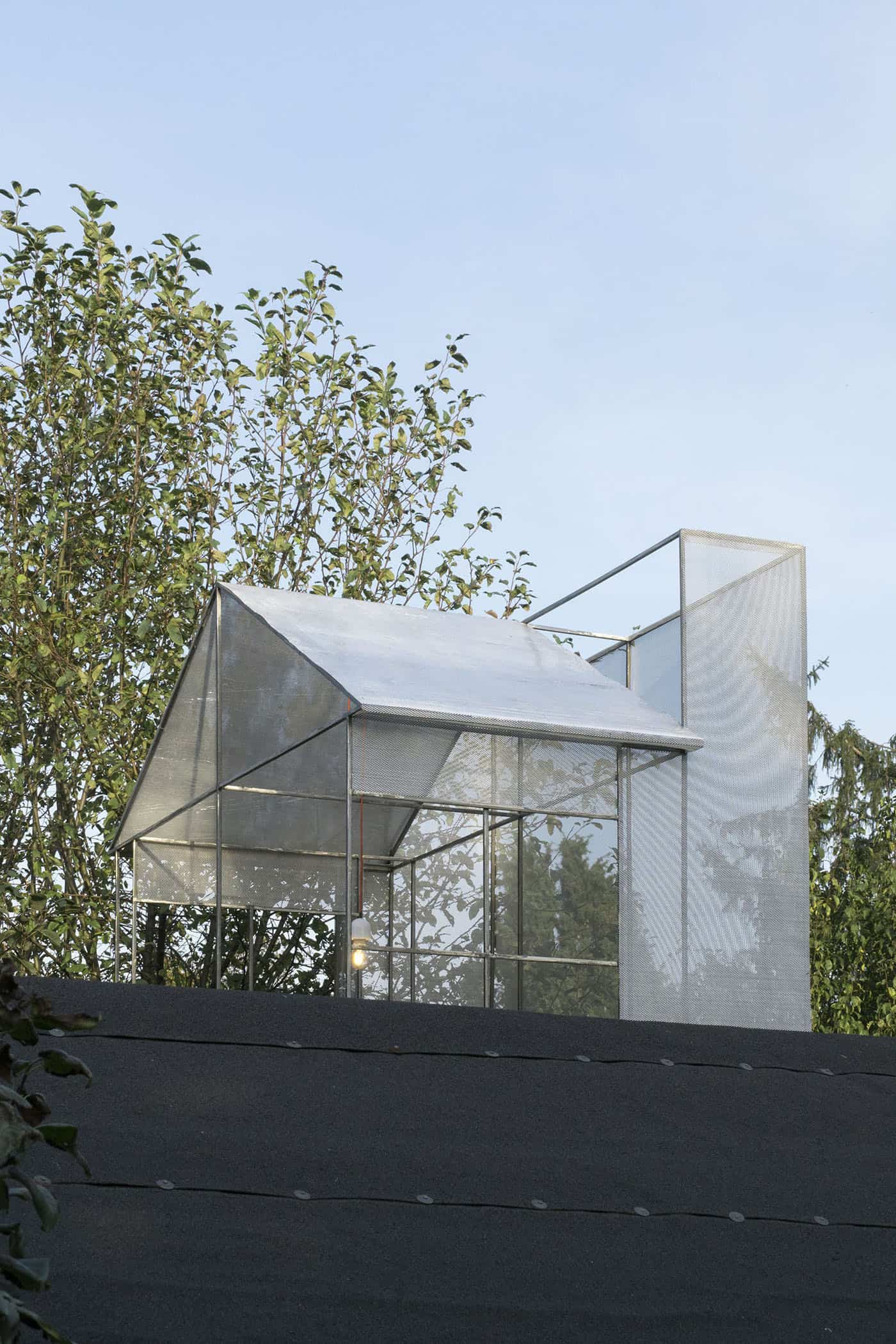 Jan Domicz, BnB, 2017, Gardening allotment. Sculpture placed on top of R.O.D. Gallery is a 1:1 model of a characteristic lantern which lets the light into highly densified tenant houses at Warsaw Old Town. Piece is built out of materials typical for fans, air conditioners and other installations visible on an office building rooftops.