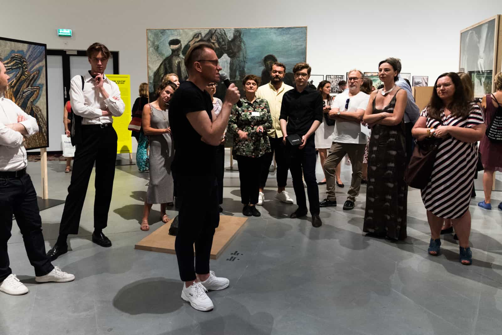 """The Friends of the Museum of Modern Art in Warsaw at the curator's guide, the exhibition """"Never Again. Art against War and Fascism in the 20th and 21st centuries"""", the Museum on the Vistula, 2019"""