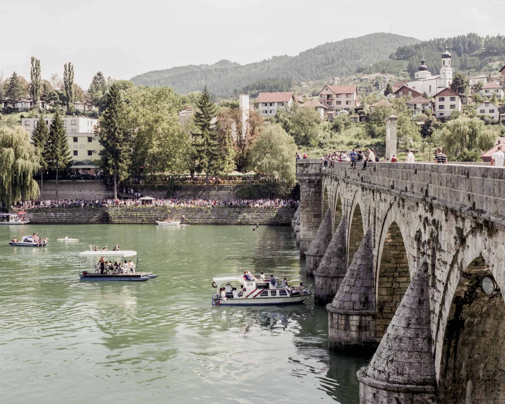 Paweł Starzec, The Bridge on Drina, Visegrad, former execution ground. Water jumping contest, from the series: Makeshift, courtesy of the artist