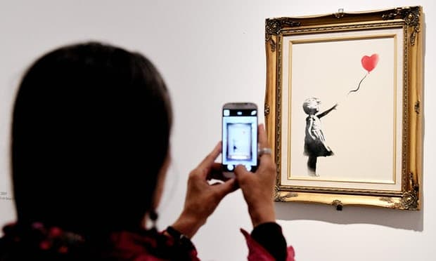 Instead of portraying a rich human being with mysterious emotions, Banksy gives us a one-dimensional icon.' Photograph: Vincenzo Pinto/AFP/Getty Images