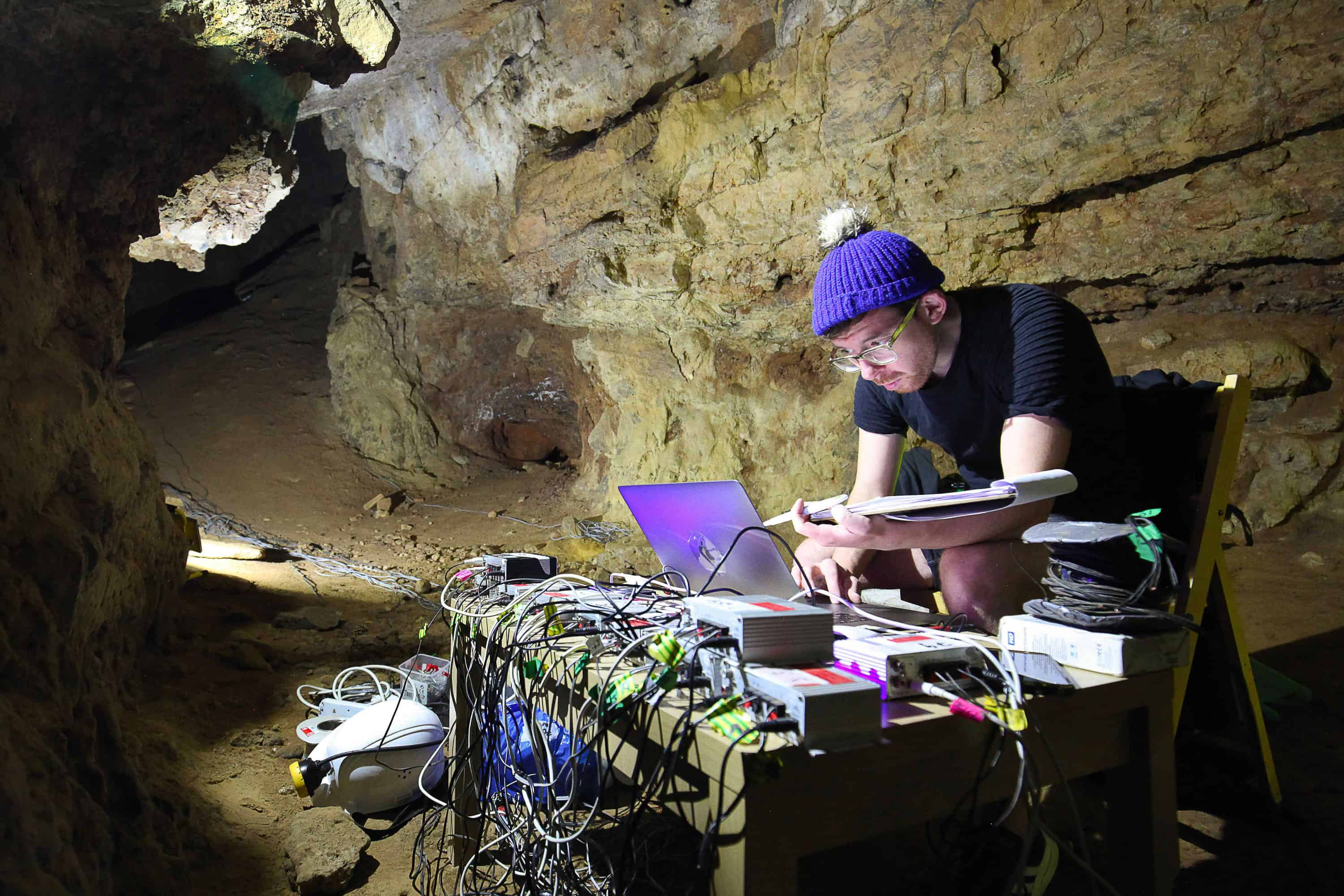 AlanJames Burn setting up Enitrely hollow aside from the dark inside Creswell Crags Caves, September 2019, Photo Marek Wolynski